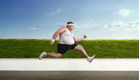 Funny overweight sportsman on the run photo