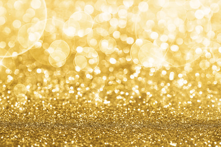 sparkles: Gold defocused glitter background with copy space