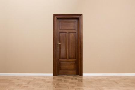 Wooden door in the empty room with copy space photo