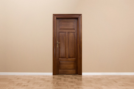 Wooden door in the empty room with copy space