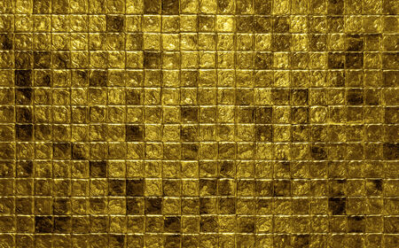 Golden mosaic tiles background with copy space photo
