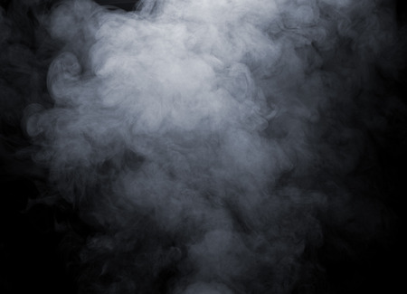 Close up of smoke isolated on black background photo