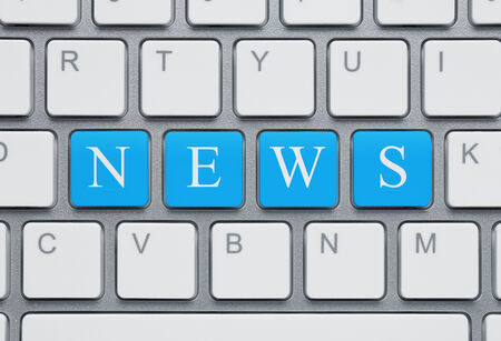 news current events: Online news concept, modern keyboard with blue keys spelling word news Stock Photo