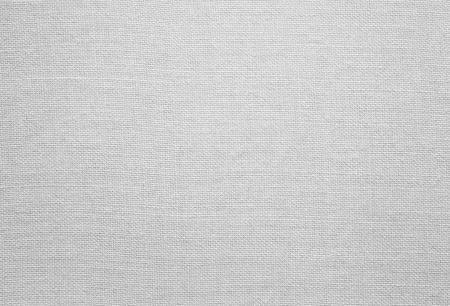 tela algodon: Textura blanca de lino, de fondo con copia espacio Foto de archivo