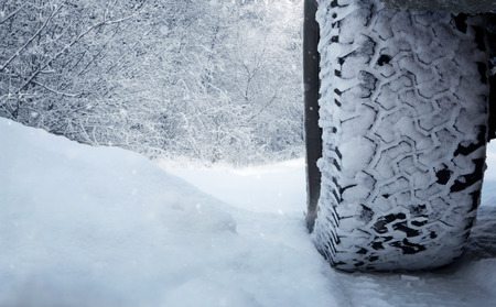 space weather tire: Close up of car tire in the snow with copy space Stock Photo