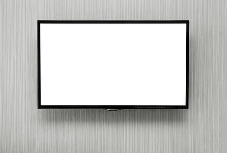 コピー スペースが付いている壁で掛かっている空白の液晶テレビ