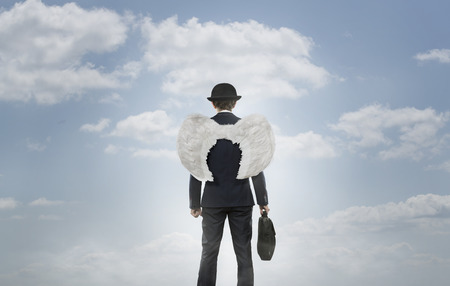 Business angel against the sky with copy space