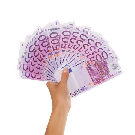 Close up of female hand holding large pile of euro currency isolated on white background Stock Photo