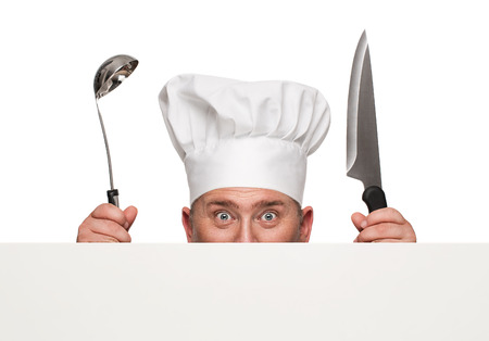 Funny chef peeking from behind the blank banner isolated on white background with copy space