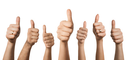 Close up of many hands showing thumbs up, isolated on white background Archivio Fotografico