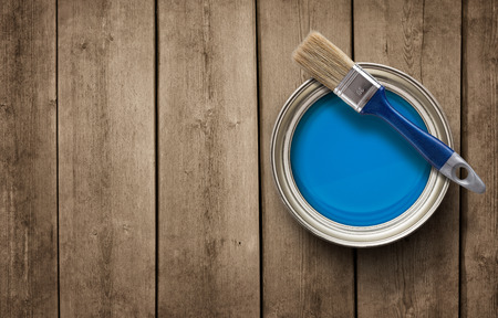brush paint: Paint can on the grunge wooden background with copy space