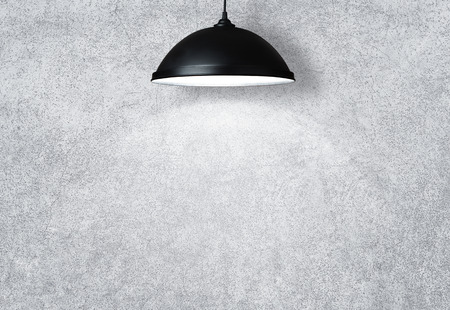 illuminated wall: White wall illuminated by the lamp with copy space