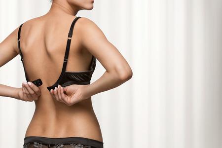 sexy nude women: Rear view of young beautiful woman wearing bra