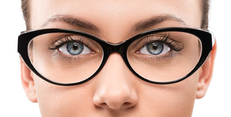 female boss: Cloese up of young woman wearing eyeglasses isolated on white background Stock Photo