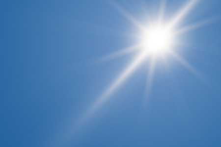 ray of light: Heat, sun shining at the clear blue sky with copy space Stock Photo