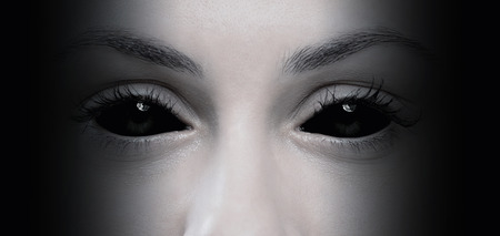 alien face: Close up of evil female eyes