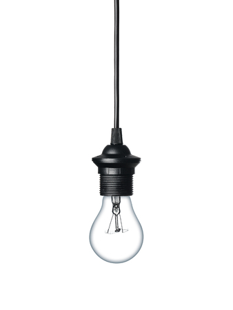 Close up of a light bulb hanging on the cable isolated on white background
