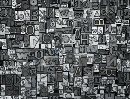 Letterpress background, close up of many old, random metal letters with copy space Stok Fotoğraf