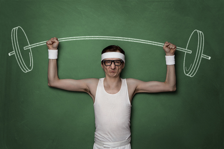 geek: Funny retro sport nerd lifting weights drawn on a chalkboard Stock Photo