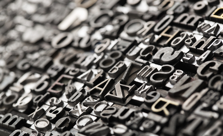 Letterpress background, close up of many old, random metal letters with copy space Stockfoto