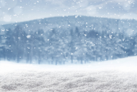 Winter background, falling snow over winter landscape with copy space