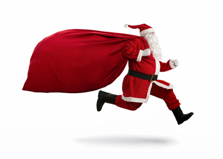 흰색 배경에 고립 된 배달 크리스마스 선물을 실행에 산타 클로스