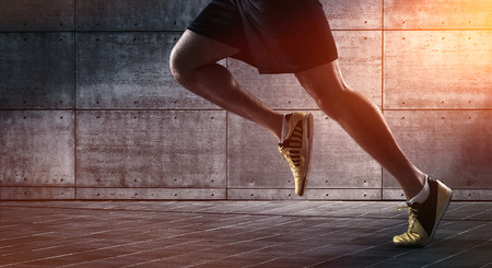 Sport background, close up of urban runner's legs run on the street with copy space Foto de archivo