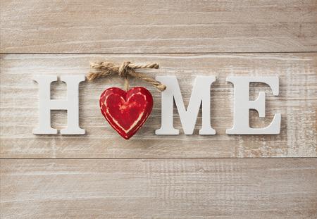 Home sweet home, texte en bois sur vintage background du conseil d'administration, avec copie espace
