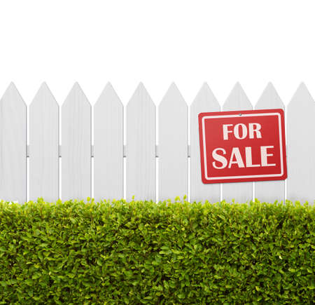 annuities: For sale sign on white wooden fence isolated on white background with copy space Stock Photo
