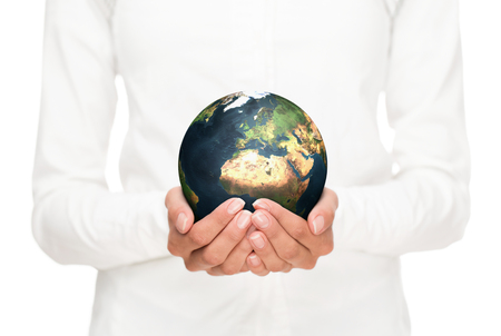 technology symbols metaphors: Environment conservation, close up of female hands holding planet earth.