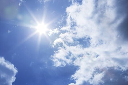 sky sun: Sun shining at cloudy blue sky with copy space Stock Photo