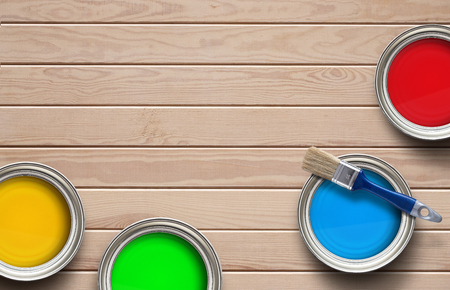 home decorating: Home improvement, colorful paint cans on the clear wooden background with copy space