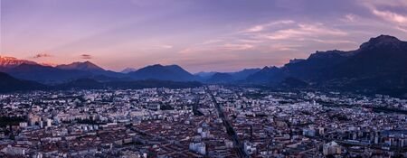 Panoramic view of Grenoble city after sunset