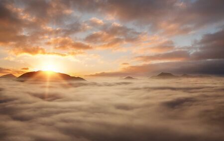 Nature background, sunset above the clouds with copy space