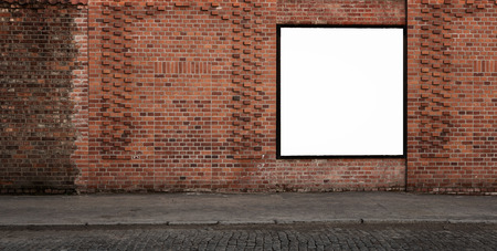 communication: Blank advertising banner on the old brick wall with copy space and clipping path