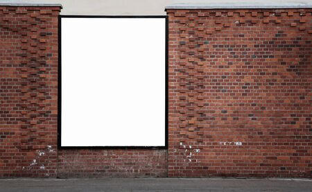 aged: Blank advertising banner on the old brick wall with copy space and clipping path