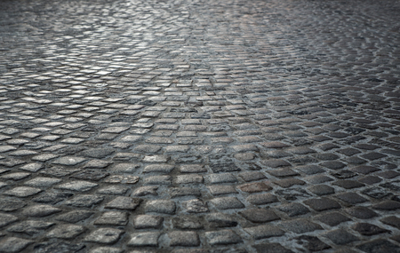 grey: Empty old cobblestone street background with copy space