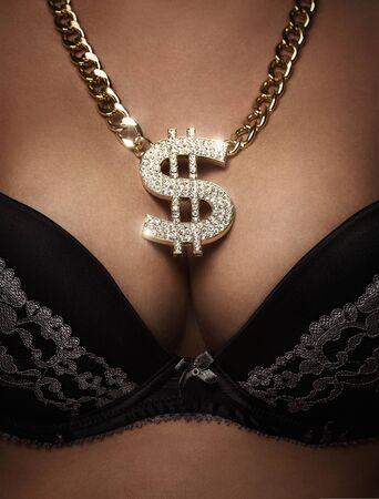 Close up of a female bust with golden, shiny dollar necklace Lizenzfreie Bilder