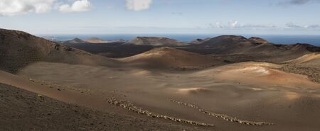 Panorama of volcanic landscape with copy space at Timanfaya National Park, Lanzarote, Spain