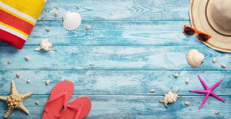 vysoký úhel pohledu: High angle view of summer, vacation, beach accessories on blue wooden background with copy space Reklamní fotografie