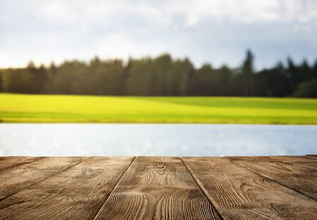 Close up of old empty wooden pier over the lake with copy space