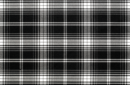Close up of black and white checkered fabric background, texture with copy space