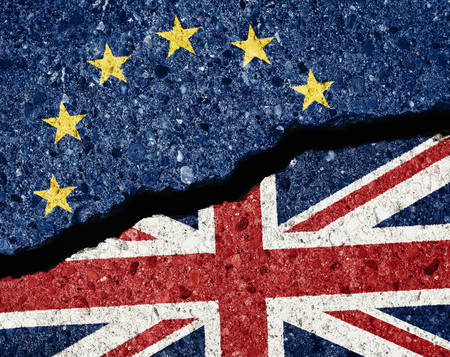 Brexit concept, crack in the asphalt dividing ue and gb flags Stock Photo