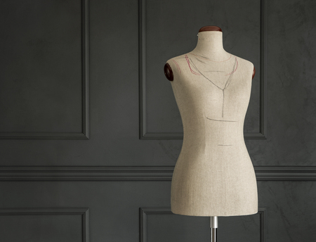 Vintage tailors mannequin in elegant room with copy space
