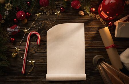 Christmas background, blank paper sheet on wooden table with copy space