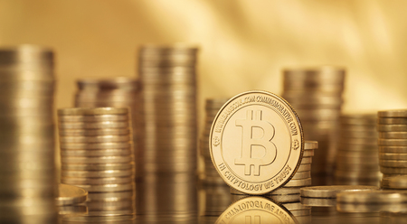 Close up of many bitcoin coins over golden background with copy space