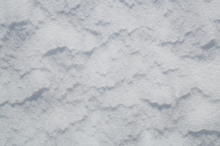 Snow dunes texture, background with copy space Standard-Bild