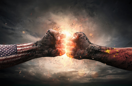 Conflict, close up of two fists hitting each other over dramatic background with copy space Stockfoto - 101195074