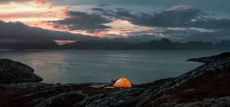 Tent on the hill at the Lofoten islands, travel adventure concept
