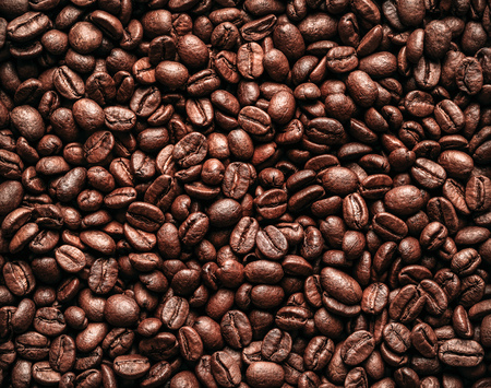 Roasted coffee beans background, texture with copy space
